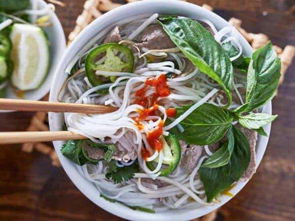 Slurping-a-bowl-of-Vietnamese-noodle-soup
